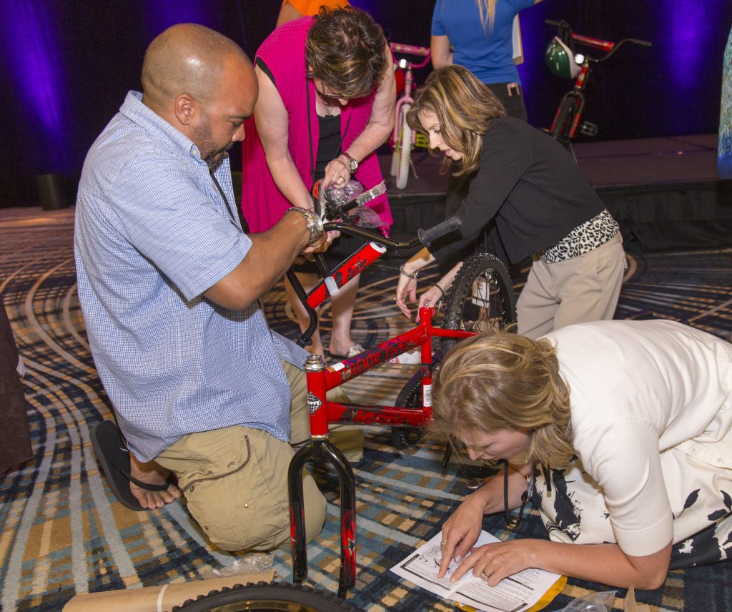 The MTA team participating in the Build-A-Bike project at the MTA 2015 Workshop.